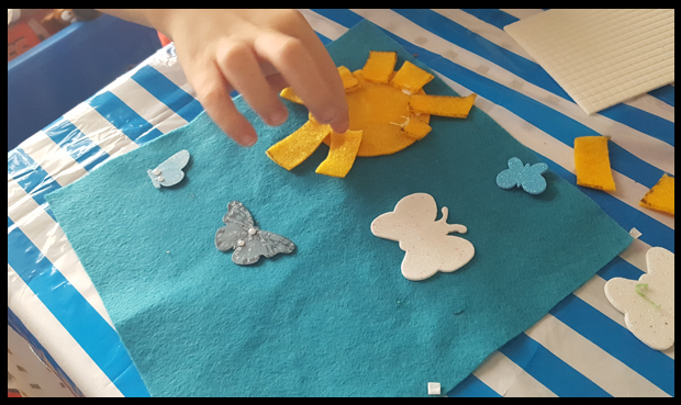 Creating a sky scene using Bostik foam pads and blue felt