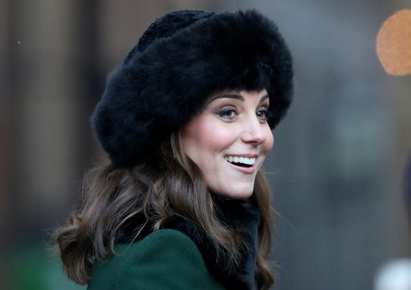 Kate Middleton wore a new bespoke Catherine Walker coat and dress. Duchess accessorised her coat with a faux fur collar and faux fur cuffs from Troy London