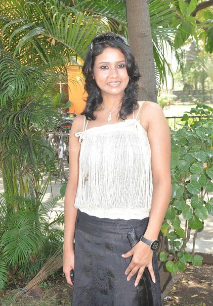 Urmila in mini skirt and sleeveless top hot photos