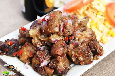 nigerian Asun Recipe ( spicy smoked peppered goat meat) | Nigerian Small Chop