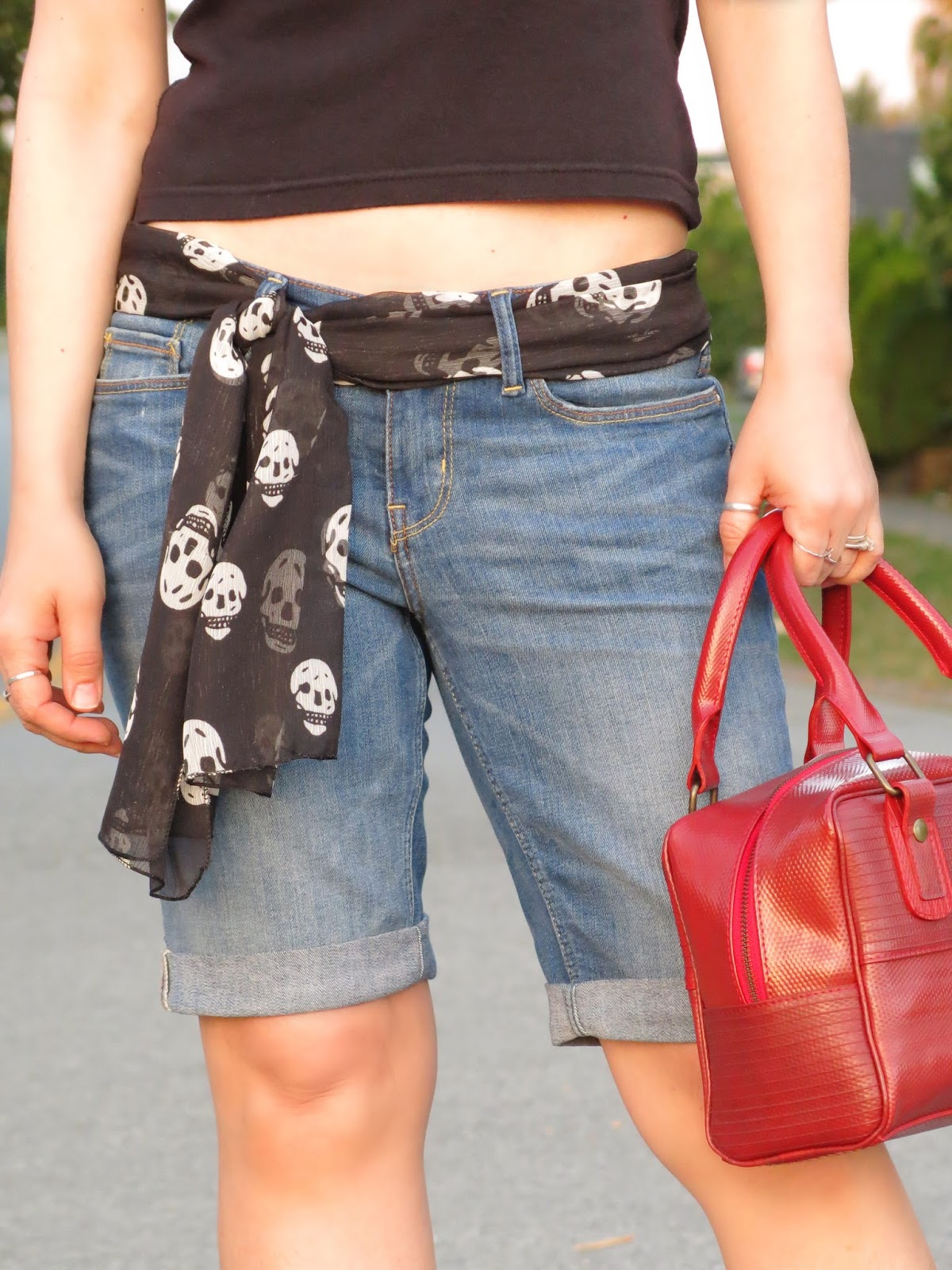 denim bermuda shorts, scull-print scarf, and Elvis & Kresse bag