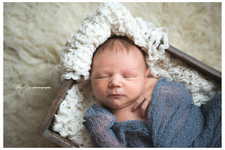 Baby photo with newborn in box wrapped with blankets