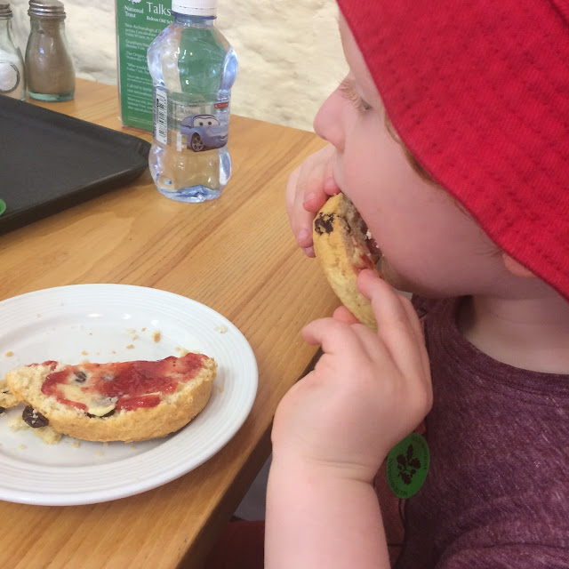 Child eating a scone