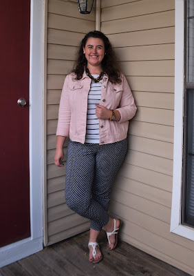 a striped tee, polka dot pants, a denim jacket, a statement necklace, and sandals