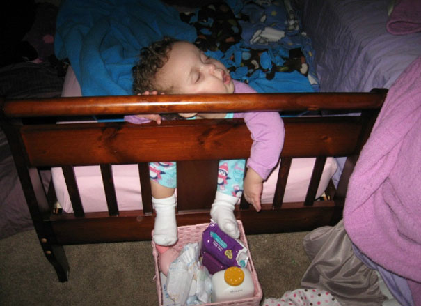 15+ Hilarious Pics That Prove Kids Can Sleep Anywhere - Napping By The Footboard