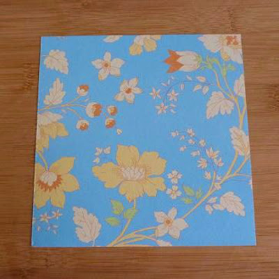 Blue patterned floral paper for making folded origami projects craft