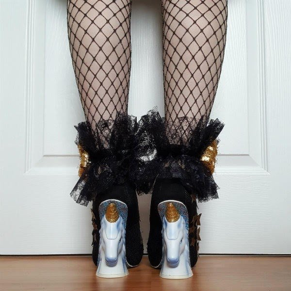 back view of legs in unicorn heeled shoes with black lace hand sewn ankle cuffs