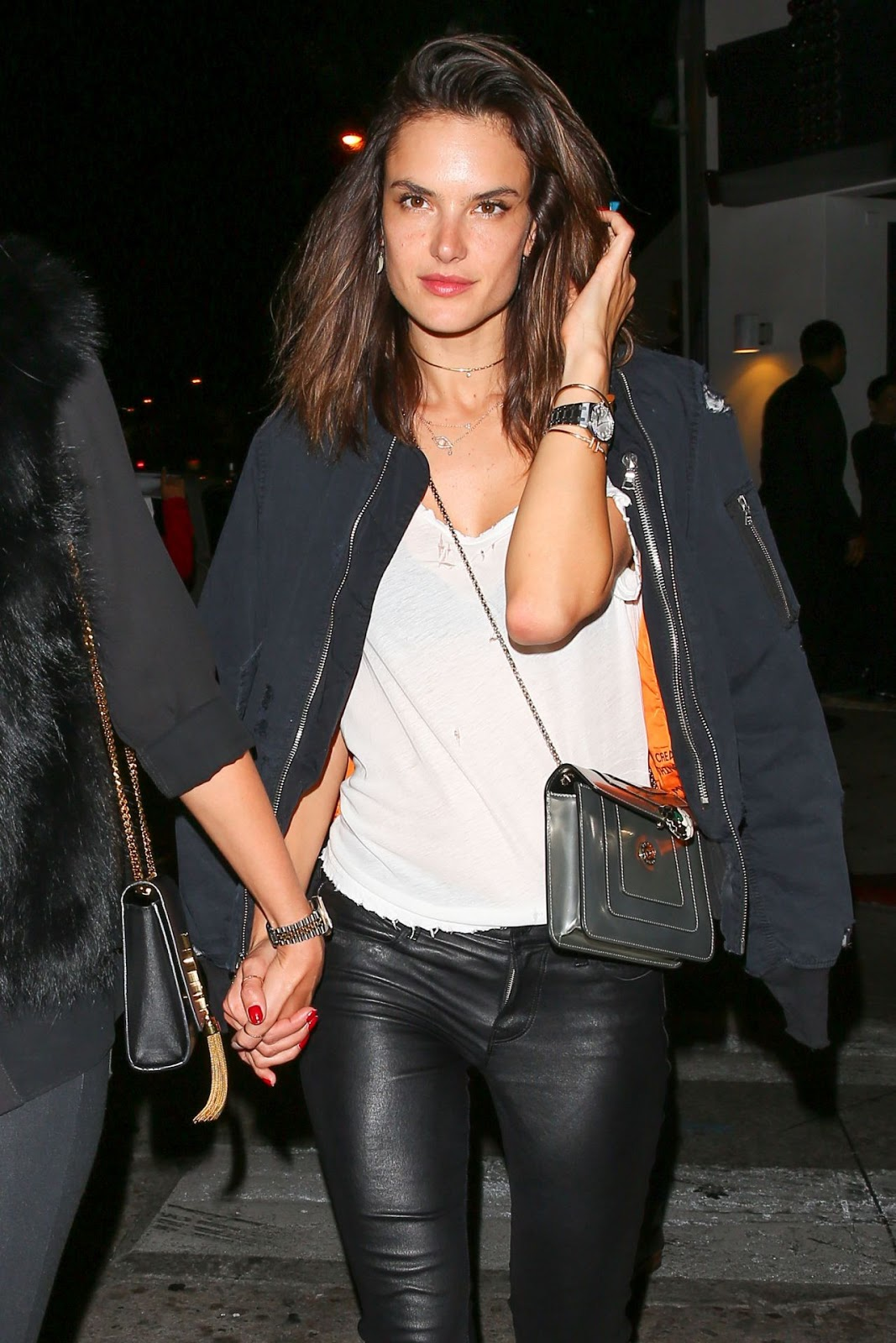 Alessandra Ambrosio parties with pals in leather trousers and bomber jacket