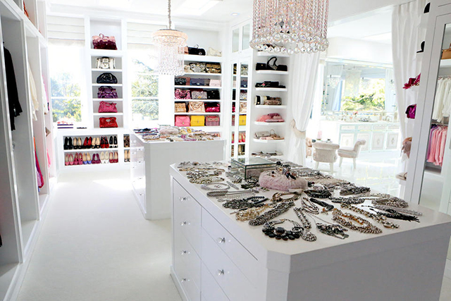 White closet with chandeliers.