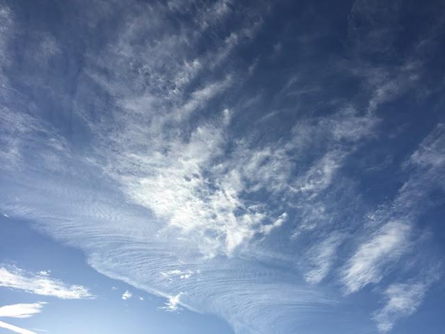 blue sky wispy clouds
