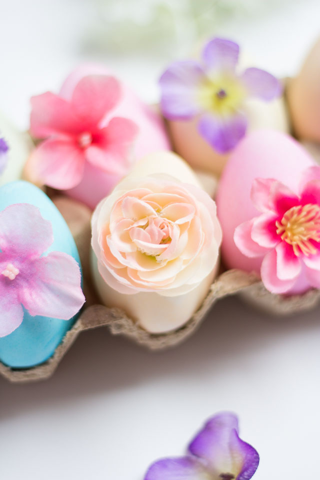 Flower Easter Eggs - decorate dyed eggs with small artificial flowers for gorgeous results! | http://www.designimprovised.com