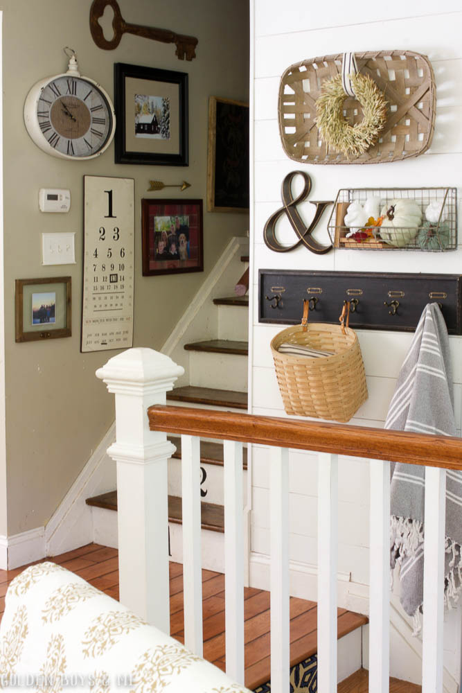 living room items. This gallery wall with hooks and wire basket serves as a landing spot for  many items in our home Please excuse the scuff marks on stairs Golden Boys Me Fall Dining Living Room