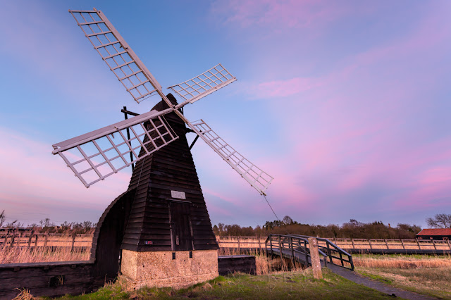 Wooden windmill at Wicken Fen at dusk in the East Anglian Fens