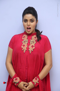 Actress Poorna Latest Stills in Red Dress at Rakshasi First Look Launch  0059.JPG