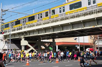 Tokyo Marathon 2017 happening under the Chuo-Sobu line, Asakusabashi, Tokyo.