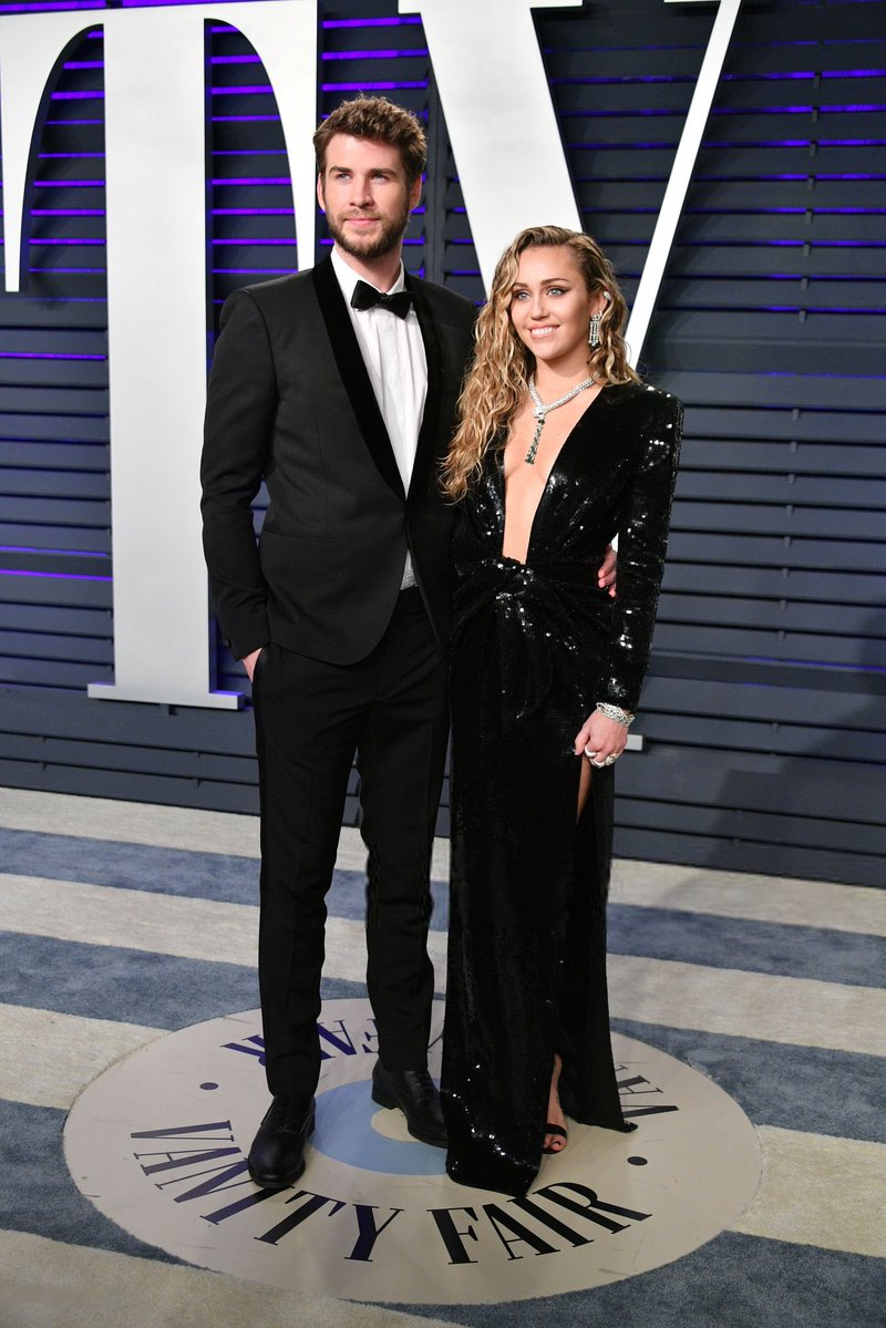 Miley Cyrus and Liam Hemsworth set the heat up at the 2019 Vanity Fair Oscars Party