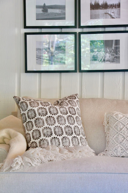 Detail of sofa. Cozy cottage style with black and white in a lake house byy Sweet Savannah. Modern farmhouse meets coastal cottage style! #cottagestyle #modernfarmhouse #interiordesign #rusticdecor #coastalcottage