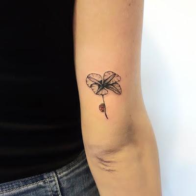 men ladybug tattoo