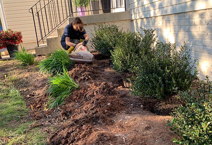 Cristina Garay planting a new garden