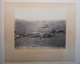 """Harvest of Death"" from Gardner's Photographic Sketch Book showing dead soldiers on the field of Gettysburg"