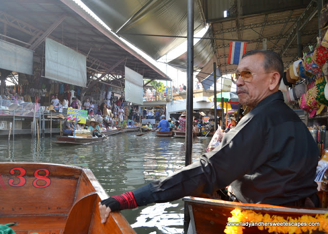 local vendor in floating market in Thailand