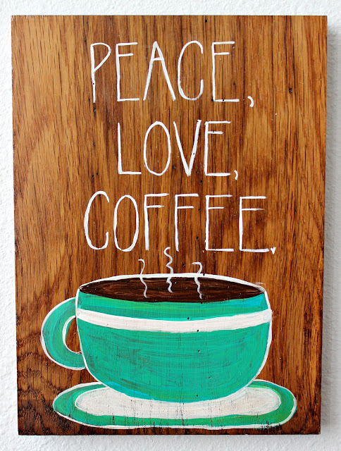 Peace love and coffee sign hand painted on reclaimed wood