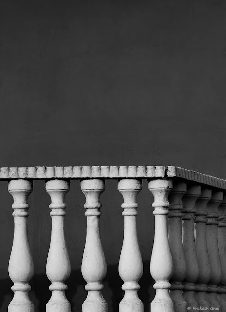 A Black and White Minimal Art Photograph of the Cement Railing of the Balcony of a house located at Tonk Road, Jaipur.