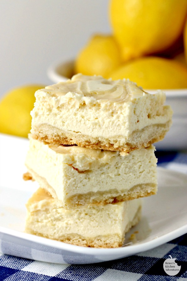 Creamy Lemon Swirl Cheesecake Bars | by Renee's Kitchen Adventures - easy dessert recipe for lemon cheesecake bars #RKArecipes #lemon