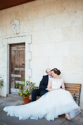 bride and groom outdoors photo on bench