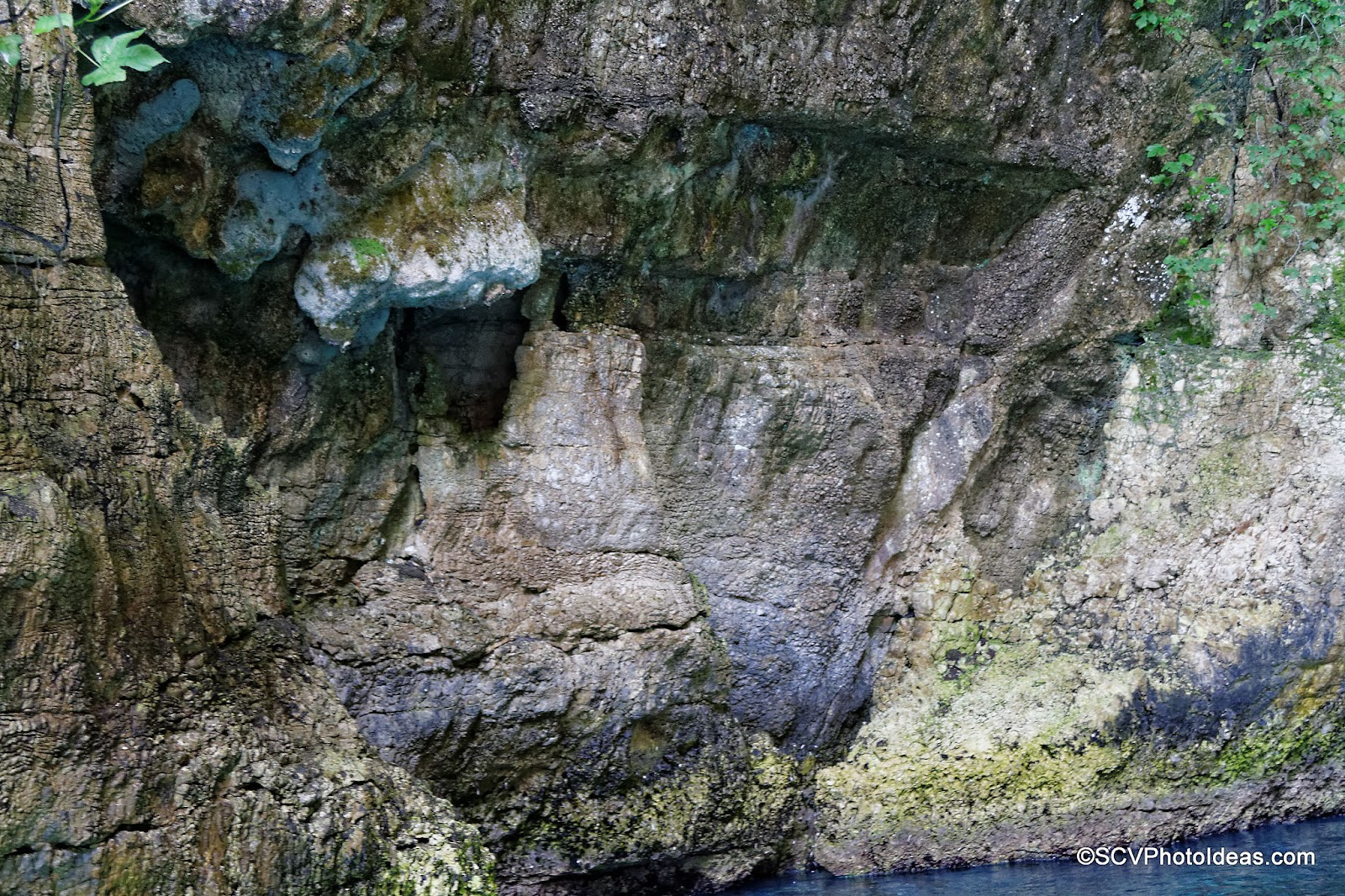 Melissani Cave wall carvings