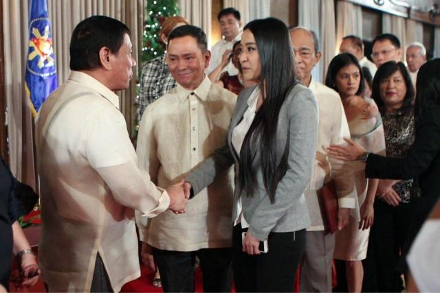 """President Duterte defended the appointment of celebrity blogger and campaign supporter Mocha Uson to the new position of Presidential Communications Operation Office  Assistant Secretary for Social Media. Prior to this appointment, Duterte appointed her as MTRCB Board member a few months back, a position she is now vacating. Previously known for leading the all-female group Mocha Girls, Uson became one of the staunchest supporters of then candidate Duterte. During a press conference before leaving for his state visit to Cambodia,  President Duterte was asked about his appointment of Uson. The president straightly answered that it was his own idea to appoint Uson, stating that """"There is nothing wrong with the woman, she's bright, she's articulate, and if it's just the matter of dancing, she was not dancing naked, a little bit sexier than others. That should not deprive her of the """"honors that she deserves, it's a matter of intellect."""" Mr. Duterte said. """"Her dancing, it's a job, a livelihood,"""" the President added.  """"There's no law which says if you expose half your body with a shorts and bra, you are disqualified from being the President of the Philippines,"""" President Duterte further stated. The president went back to Mocha's contributions to his campaign, saying Mocha and her group believed in him and has campaigned for him without asking for anything in return. Duterte emphasized that it was his turn to believe in Uson. He believes that Mocha is qualified for the post, citing the time she spent in his campaign. She sees Mocha as intelligent, one you can listen to and debate with. The president further cited Mocha's experience and her huge following in social media, saying she can have a very structured mind.  As a Palace official, Uson will be in charge of social media and will be producing social media content, said presidential spokesperson Ernesto Abella.  Some of the reactions questioned Uson's lack of Civil Service qualifications. But since presidential appoint"""