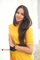 Actress Poojitha Stills in Yellow Short Dress at Darshakudu Movie Teaser Launch .COM 0084.JPG