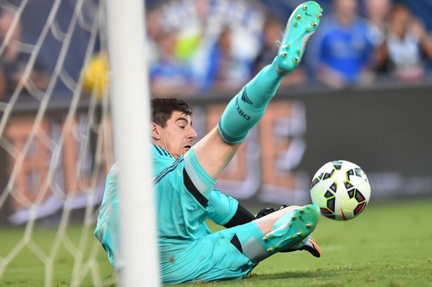 Thibaut Courtois stops the crucial penalty in the shootout, before scoring the winner himself