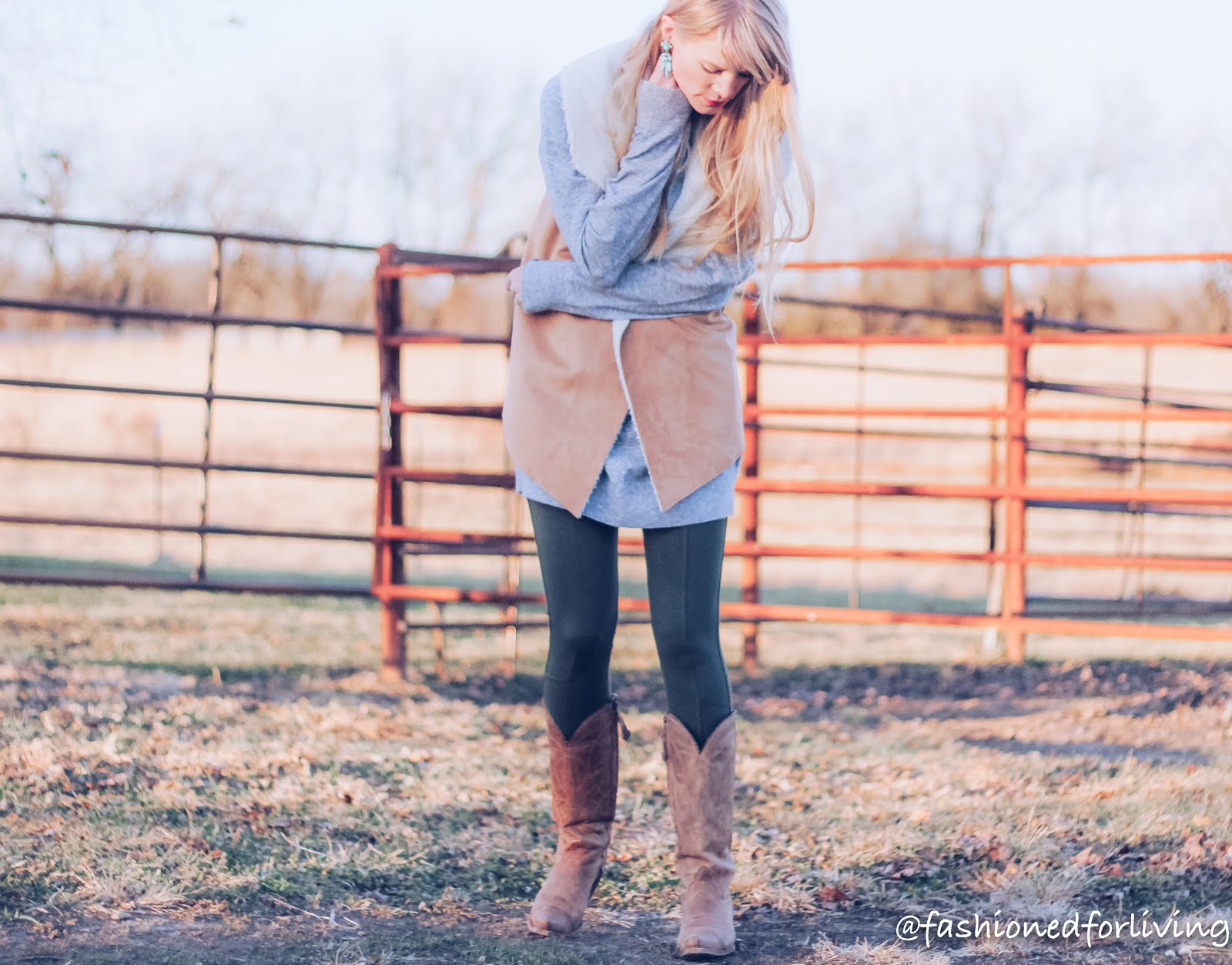 olive green leggings outfit - sweater dress, shearling vest and tall cowgirl boots