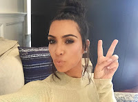 Why Is Kim Kardashian's Topknot so Big? It's Full of Secrets (and a Genius Hair Tip)