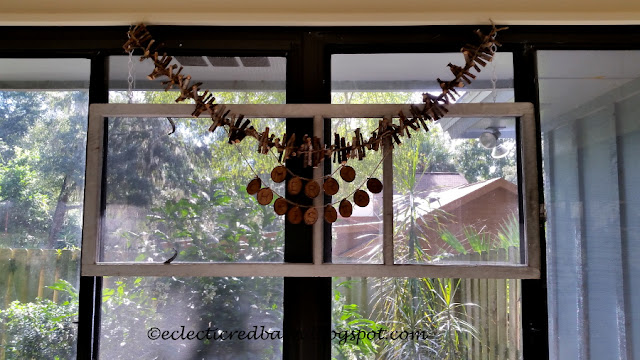 Eclectic Red Barn: Old screen with wooden garland and Merry Christmas sign