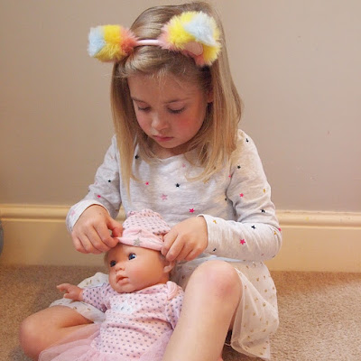 Ellie dressing her Tiny Treasures Baby