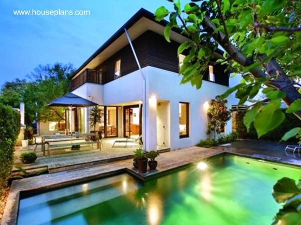 Perspectiva de una moderna casa estilo Contemporáneo con piscina exterior