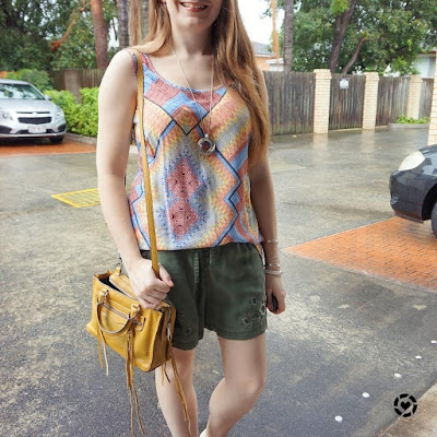 awayfromblue Instagram | colourful mixed print tank with neutral olive shorts mustard rebecca minkoff regan bag