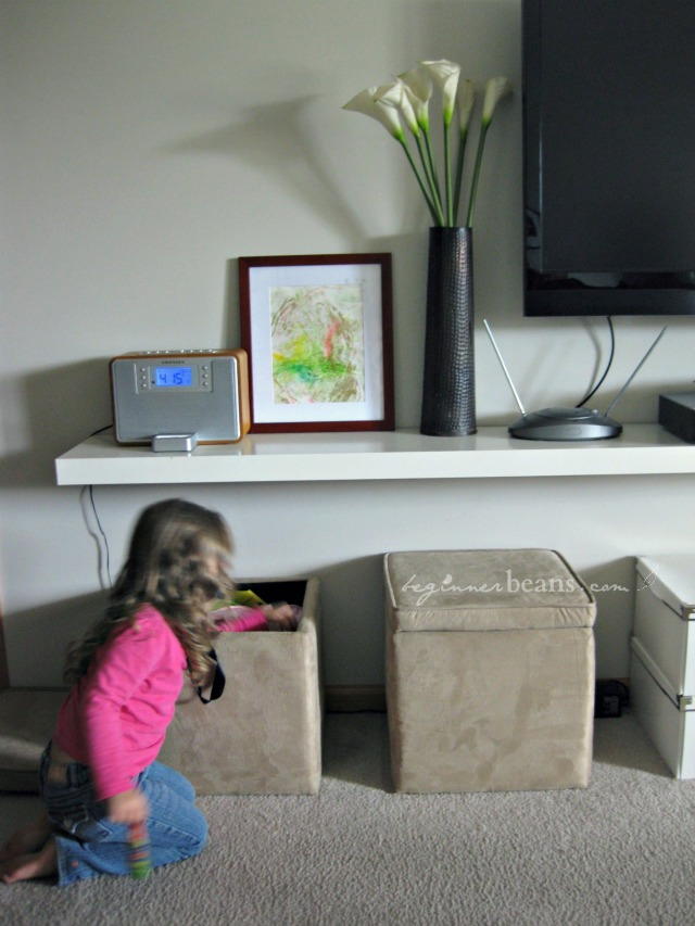 small space with kids: hide toys away in ottomans