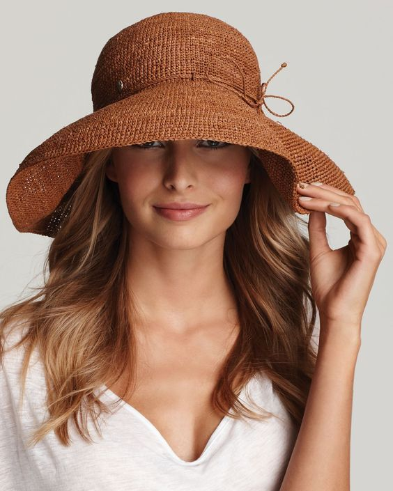 Lady in white T-Shirt with Knitting Brown Color Hat