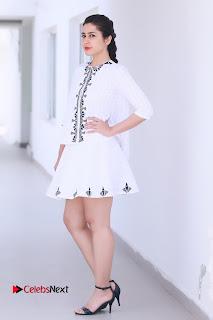 Actress Rashi Khanna Latest Pictures in White Short Dress  0004.JPG