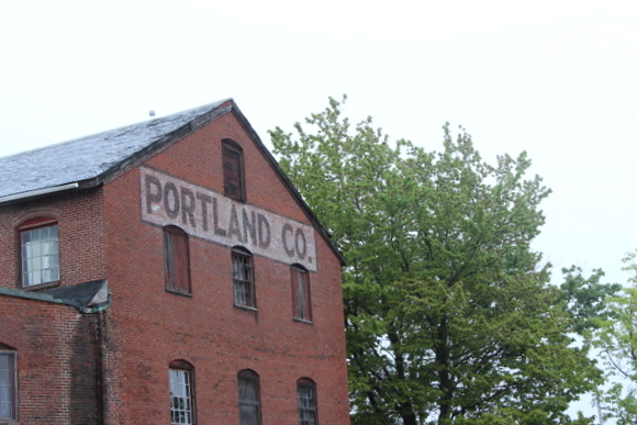 The red brick on this Portland Co. looks great next to the tall green trees.
