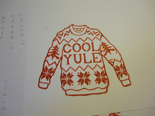 Red and white stamped knitted jumper with Cool Yule sentiment