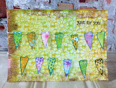 Close up of fabric hearts bunting card
