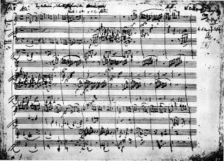 """Primera página de la """"Sonata para piano a cuatro manos en do mayor"""", Kv. 521, donde se observa como Mozart indica en cada una de la partes """"Cembalo primo"""" y """"Cembalo secondo""""."""