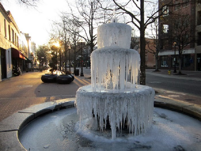 Fayetteville, N.C. - Winter Blast Transforms Water Fountains Into Magical Ice Sculptures