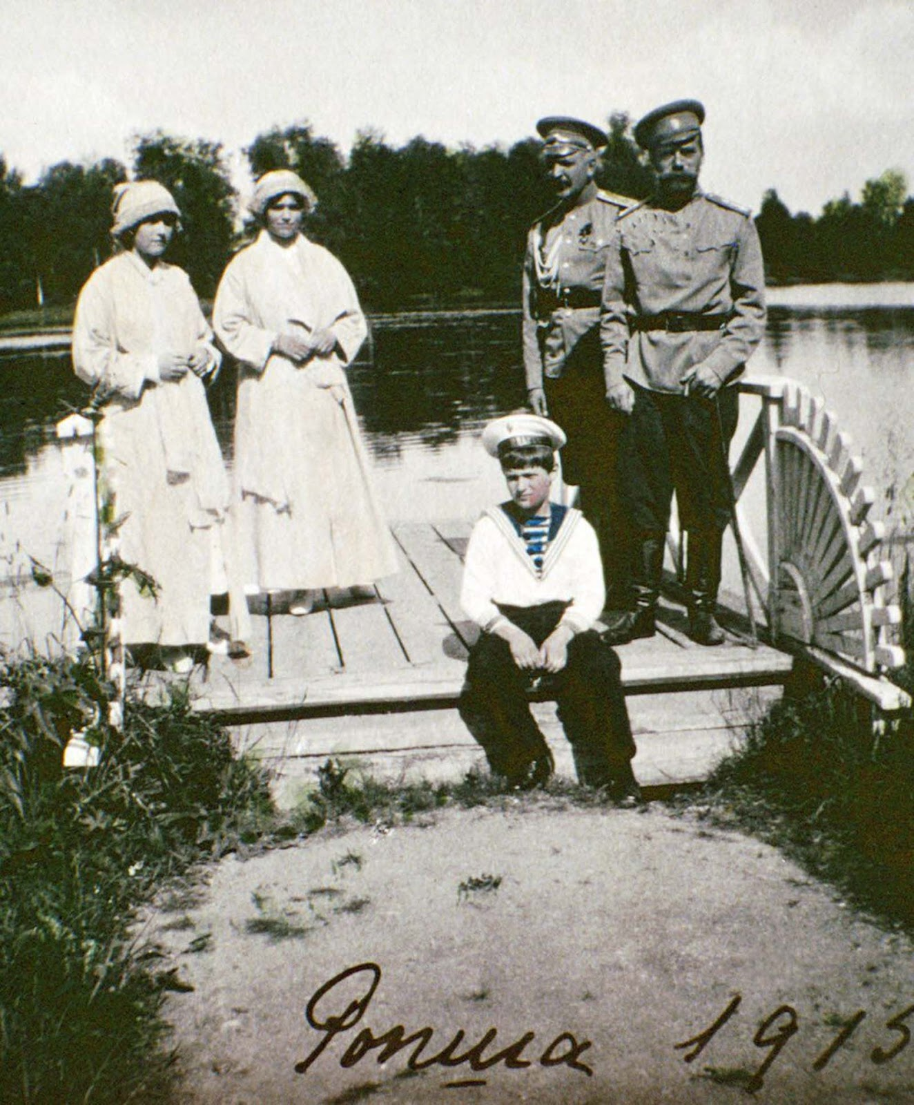 Olga, Tatiana, Alexei, an unidentified man and Tsar Nicholas II in Rospha, Russia.