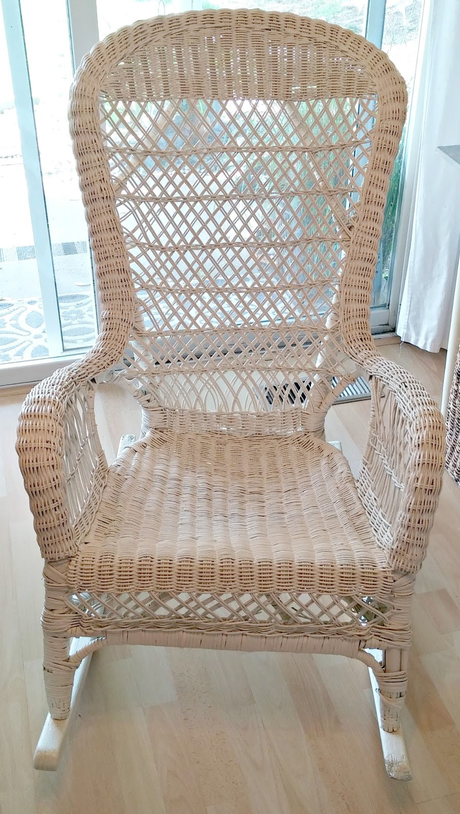 I gave the whole thing a quick sanding/cleaning and then sprayed it with  Heirloom White. - Vintage Wicker Rocking Chair Makeover - Little Vintage Cottage