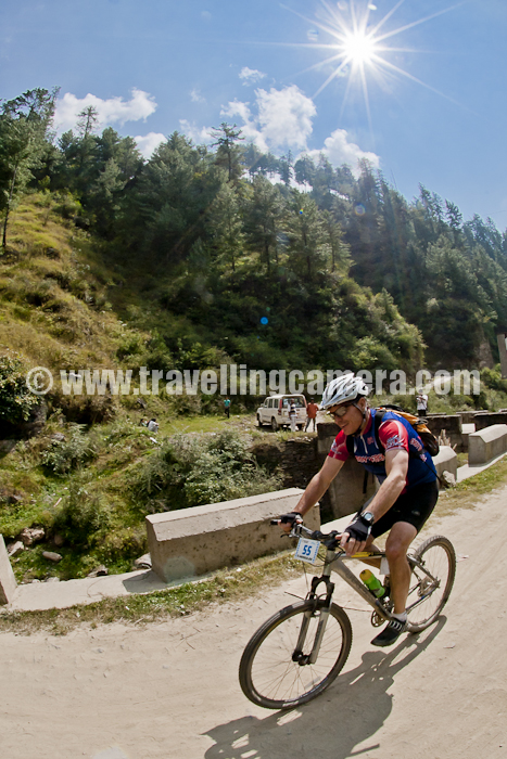 After extremely hectic day-1 of MTB Himachal 2011, it was fresh morning at Ghada Kufar... Since last night we reached in the dark, it was beautiful surprise in morning... What a wonderful place it was... So today's PHOTO JOURNEY started from Ghada Kufar's lush green ground surrounded by huge cedars ...Most of the folks are out of their tents and getting ready for Day-2 of MTB Himachal 2011... Wonderful sunlight, soothing sounds, fresh air and all officials/Marshals in hurry:) ... I can't forget breakfast between 6:30 am to 7:30 am...Competition to get first entry :)Sunlight has started touching green ground of Ghada Kufar and it's an indication that we are getting late to start the day... Today I thought of joining media folks, so that have flexibility of moving ahead of riders to have some shots at appropriate place...Miss Monika, 1st runner up of MTB Himachal 2011 !! All these folks take good care of their cycles.Another photograph of colorful camping site at Ghada Kufar, Shimla, Himachal Pradesh !!!Doordarshan folks taking interview of winning team of day-1 @ MTB Himachal 2011Bike outside the tent waiting for rider @ Ghada Kufar, Shimla, Himachal Pradesh...Morning tea is being served at other corner of Ghada Kufar ground... Mr. Anil Perfect Sharma !!Both of them were searching for tents last night till 12:30 am ... now trying to forget those moments by such activities :)Panoramic view of Ghada Kufar ground from a hilltop... Some of the tents are already packed...All riders getting ready for first stage of Day-2 which is about to start from a small market near water pond...Mr. Nikhil, a weekend rider who had quit after second stage of Day-1 @ MTB Himachal 2011..Add captioNepali folks easily get bored if they have to wait for a longer time without riding and the term 'longer period' is very subjective :)Army riders having sunbath during the wait time...Ha ha ha... We completed first stage...Why these folks are doing time pass and making me wait for next stage :) ... Do these expressions say this?A photograph from Ghada Kufar ... Water pound surrounded by Himachali houses and a small market...Finally Stage one started after waiting time for 45 minutes...Mr. Aneesh kept telling me about clicking photographs for branding as well... Although I clicked, but he always noticed me clicking riders and landscapes :)Highway near Matiana was in very bad shape but riders don't like smooth roads, so they were happy :)Army team crossing Matiana and reaching Shilaroo stadium .... During MTB Himachal 2011, Shilaroo stadium was decided as place for lunch break...Mountain Terrain Bikes waiting at Shilaroo Hockey Stadium. As told by some folks in the troop, it's highest Hockey Stadium in Asia...Here is another view of Shilaroo Hockey Stadium.. This Photograph is clicked from main highway...Stage two has started from Shilaroo Stadium and now folks are moving towards Hatu Peak... Hatu peak was highest point of MTB Himachal 2011...One of the tired rider dragging his bike on a rough track during MTB Himachal 2011 !!! Mountain Terrain Biking is verydifferentexperienceanditneedshigcommitmenttcomplete...Rider number 55 climbing up through a village near Narkanda... Most of these uphills and downhills were extremely tough and this time route was toughest one in India... Lasttime during MTB  Himachal 2010, there was no serious injury and this time three folks got major injuries... Out of three, one was seriously injured...We met this kind man who saw us walking up and offered tea at his place ! Since we had to catch riders on hill top, we missed this opportunity :)Media gang ! Pawan, Chandan, Saurabh, Vikas and Rohit ... Happy to see tarmac near Hatu base...Dhananjay sharing information about different stages of Day-2... Every morning all the rider are briefed about different stages, distances between differentpoints,kindofterrains etc... Although all the riders keep a route map with them with all details about altitude, distance etc.NIrjala climbing up towards Hatu Peak, which is one of the wonderful place during this trek...Cycle need some rest on the way to Hatu because the route is extremely steep and weather was changing during the evening... It was very cold on top...Just 3 Kilometers away and on back route all of them had to walk with their bikes... Most of the times, there is no path to ride and one needs to pickthebikeordragitcarefully... Although some crazy folks were there, who rode on rough hills as well... I have few videos which will be shared soon...Bike Marshal are waiting for riders to come back and deviate from main road to walk down through dense forest on Hatu peak... There was noproperpathtoridethebike,sojustpick/drag through the forest and reach camping site at Tani Jubber...Rider No 108, Mr. Darshan Singh, stuntman of MTB Himachal 2011 !! Especially he was superactive i front of Cameras :)Chief Bike Marshal and one of the official of Mountain Terrain Biking Himachal - Mr. Aneesh Airborne Awasthi !!! A Great person and motorbike professional ... He hasbeenwinnerof various bike races across the country !!! And don't miss his unique adventure @ Climbing, Falling, Stumbling, and Crawling to the Hatu Temple : MISSION HATU PEAK(21FEBRUARY2011) - by Aneesh Airborne AwasthMr. Aneesh showing off MTB Himachal 2011 Batch on his hat !Hatu Temple @ Himachal Pradesh, INDIAFinally we reached Camping site at Tani Jubber !!!Keep watching this place to know about next 7 days of Mountain Terrain Biking Himachal 2011...More Photographs of the event to come... So keep watching this place and get in touch at VJ@travellingcamera/ripple4it@gmail.com in case of more information about this event !!!